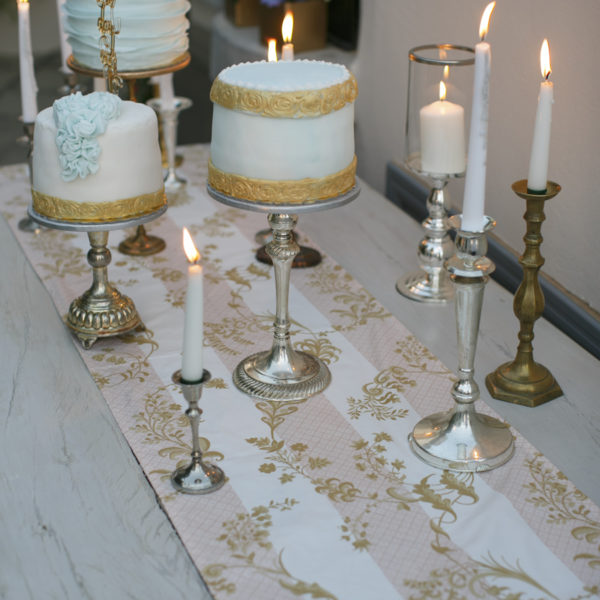 A range of delicate candlestick cake stands