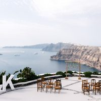 Mismatched wooden chairs perfect for Santorini ceremony and reception