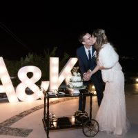 Cake cutting in front of light up letters