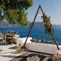 Elopement set up with caldera Santorini view